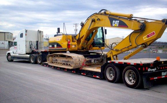 Heavy equipment hauling heavy