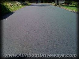 a closeup of an asphalt driveway installed by an allaboutdriveways.com trusted contractor user