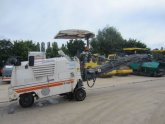 Asphalt milling machines